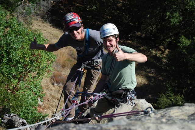 Learning to transition a counterbalance rappel to a tandem rappel. Notice the back-end of the rope munter-muled off counterbalancing the two people, allowing for an easy transition even with an unconscious victim.